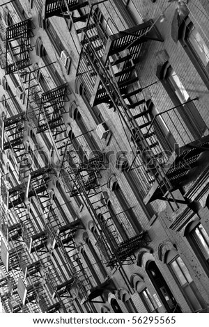 black and white of metal fire escapes outside buildings in Manhattan, New York