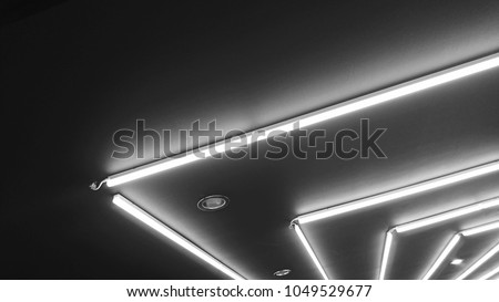 Black and white of neon lighting decoration under gypsum false ceiling. Neon light bulb linear type illuminated background
