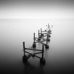 Black and white of old jetty at tropical beach