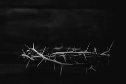 Black and white  of  the crown of thorns of Jesus on  wooden background with copy space, can be used for Christian background, Easter concept
