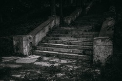 Black and white old destroyed stone steps of staircase.