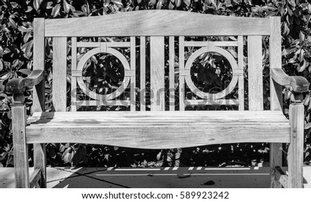 Black And White Old Teak Bench In The Garden