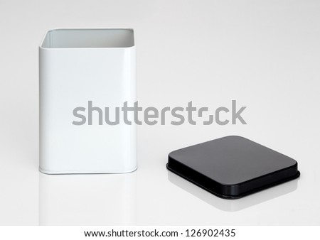 Black and white open metal container on white background - stock photo