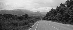 Black and white panorama A rural road surrounded by mountains in Tha Li District, Loei Province, Thailand