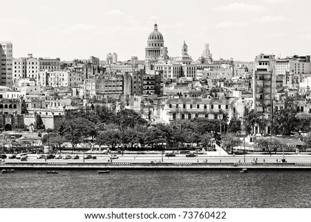 Black and white panorama of Old Havana with some famous buildings including the Capitol and the bay