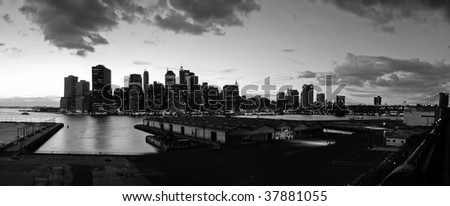 black and white panorama photo of lower manhattan viewed from brooklyn - stock photo