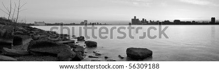Black and white panoramic image of the Ambassador Bridge connecting Detroit, Michigan and Windsor, Ontario at sunset over the Detroit River from Belle Isle