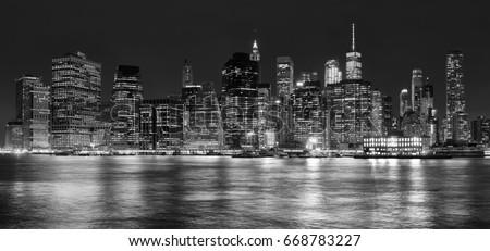 Black and white panoramic picture of Manhattan at night, New York City, USA. #668783227