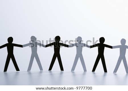 stock photo : Black and white paper cutout men standing holding hands