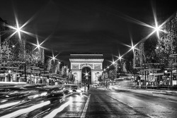 Black and White Paris: Evening traffic on Champs-Elysees in front of Arc de Triomphe (Paris, France) at Christmas Time