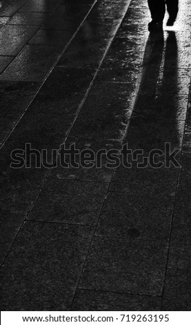 Black And White Photo City Lights Reflection In Asphalt Surface With Alone Lonely