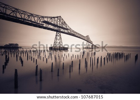 Black and White photo of a bridge in the fog