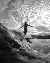 Black and white photo of a Young surfer at Tamarama Beach, Sydney Australia