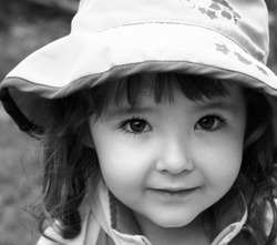 black and white photo of adorable little girl closeup