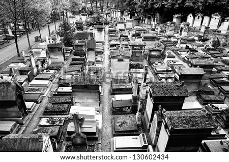 Black and white photo of an old graveyard in Paris - stock photo