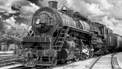 Black and white photo of an old steam engine train
