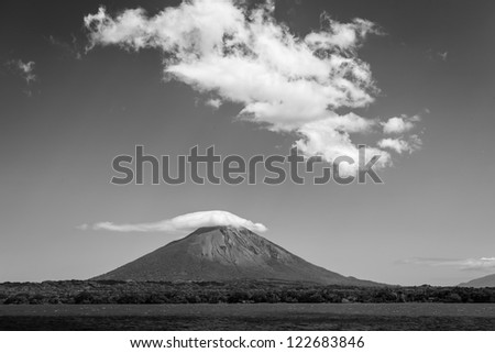 Black and white photo of approach to volcano Conception on Ometepe Island, Nicaragua from the sea.