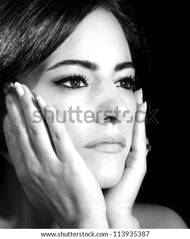 Black and white photo of attractive female touching her face, closeup portrait of brunette arabic female with perfect stylish makeup, gorgeous glamorous young lady, luxury beauty salon
