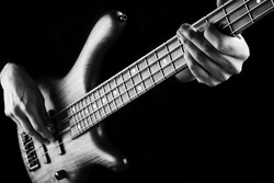 black and white photo of bassist playing electric bass guitar
