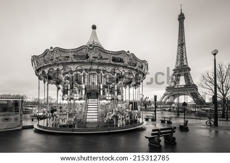 Black and white photo of Eiffel tower with a carousel, Paris, France