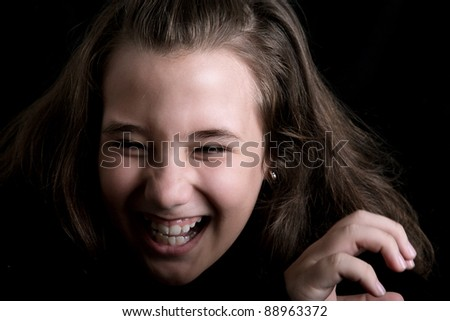 black and white photo of girl laughing out loud