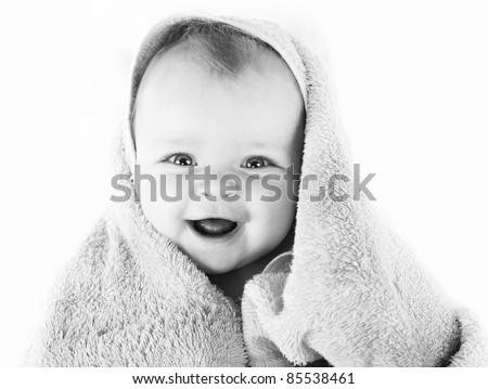 black and white photo of  Happy baby with towel