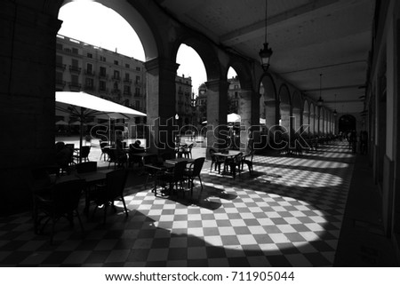 Black and White photo of light pattern through old arches #711905044