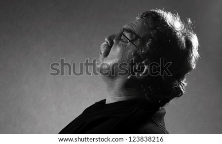 black and white photo of man resting his eyes closed