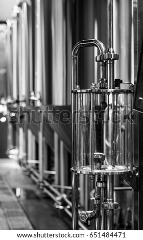 Elegant Black And White Photo Of Modern Brewery Equipment With Stainless Tanks For  The Fermentation Beer