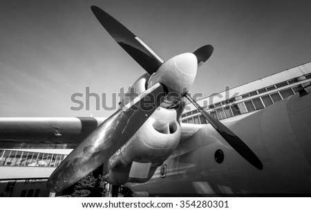 Black and white photo of old airplane engine