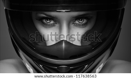 black and white photo of sexy woman in helmet on the background
