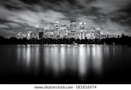 Black and white photo of skyscrapers at night, Sydney Australia