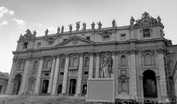 Black and white photo of St. Peter Basilica front entrance with statues, Vatican Rome