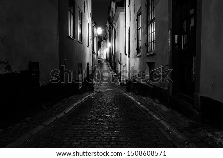 Black and white photo of the old town of Stockholm. Traditional cobbled stone streets and medieval architecture with high contrast