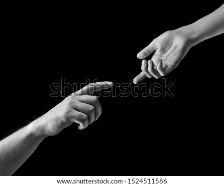 Black and white photo of two hands at the moment of breakup. The concept of  breakup. On black isolated background. Image. #1524511586