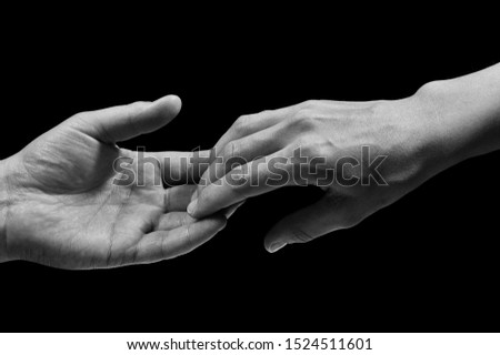 Black and white photo of two hands at the moment of breakup. The concept of  breakup. On black isolated background. Image. #1524511601