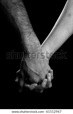 holding hands black and white photography. stock photo : Black and white photo of two people holding hands