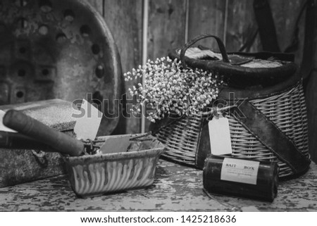 Black and White photo of vintage fishing creel and bait box #1425218636