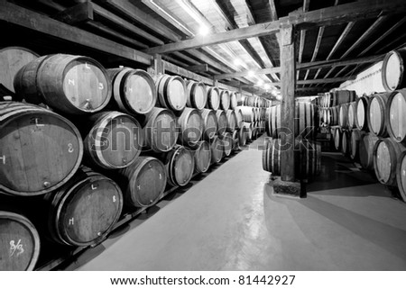 Black and white photo of wine cellar with barrels