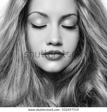 Black and white photo of young beautiful woman