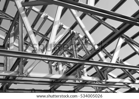 Black and white photo,Structure of steel roof frame for building construction. #534005026