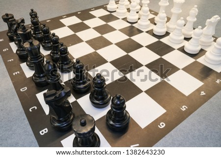 Black and white photo with a picture of a chess Board and chess pieces, chess pieces on a chess Board