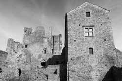 Black and white photography of the Saissac castle ruins, in France