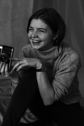 Black and white photos of girl  with an old film camera