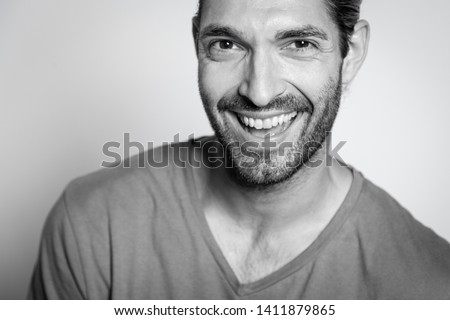 Black and white pic of an attractive caucasian young man with brown hair on white background with natural shadow