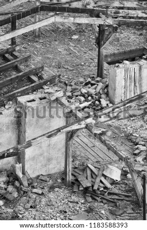 Black and white picture of a destroyed building, disaster concept.