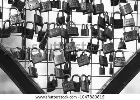 Black and white picture of a many metal lock and symbols, concept for endless love #1047860815