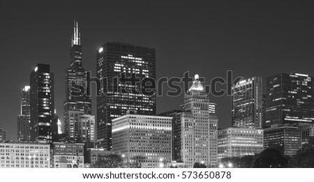 Black and white picture of Chicago downtown at night, USA.