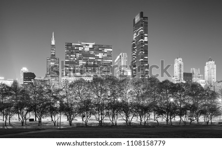 Black and white picture of Chicago skyline at night, USA.