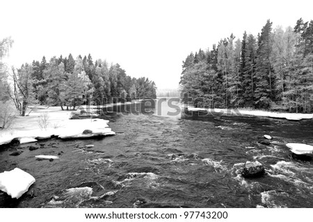 Black and white picture of frosty river landscape